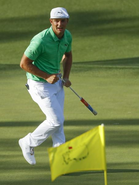 Bryson DeChambeau rects after missing a putt on the 15th hole during the first round for the Masters golf tournament Thursday, April 11, 2019, in Augusta, Ga. (AP Photo/Matt Slocum)