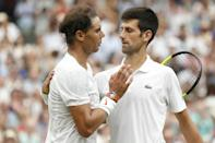 Wall of defiance: Djokovic shakes hands after beating Nadal in the 2018 Wimbledon semi-finals