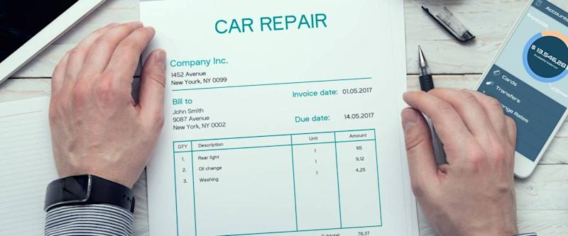 Car repair invoice on the table.