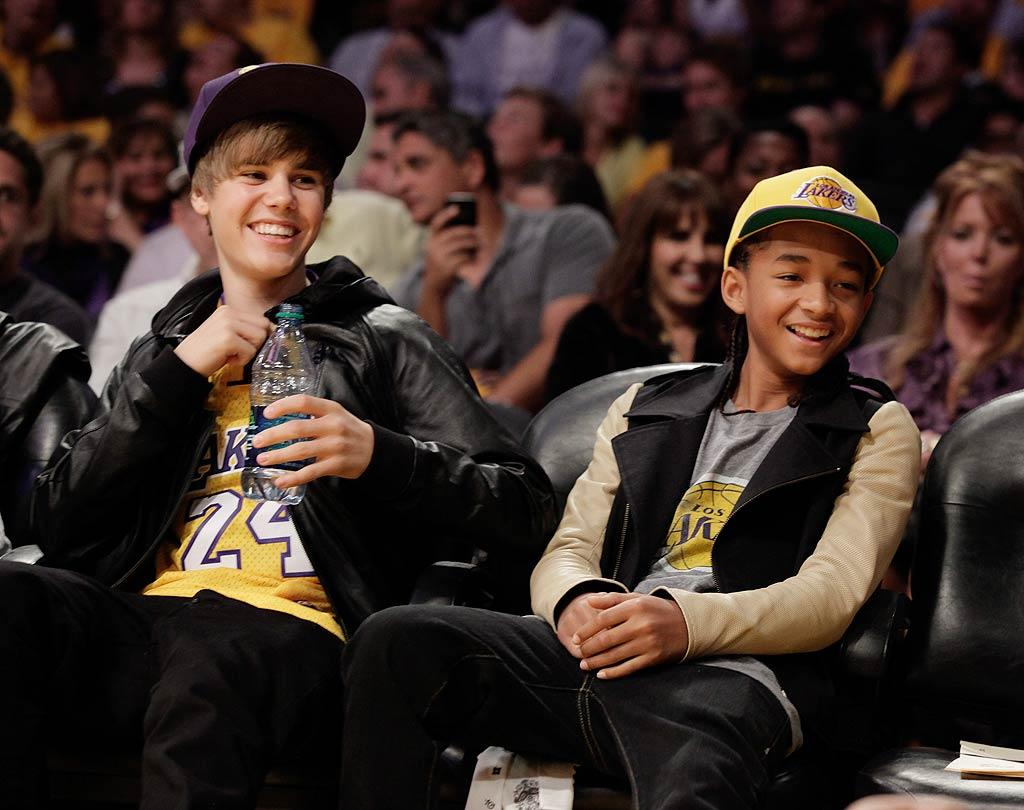"All geared up for the game, pop star Justin Bieber and ""Karate Kid"" Jaden Smith had a blast. JBiebs, who performed a sold-out show at the venue the night before, even chatted with Becks and tried on Lakers coach Phil Jackson's championship ring. Noel Vasquez/<a href=""http://www.gettyimages.com/"" target=""new"">GettyImages.com</a> - October 26, 2010"
