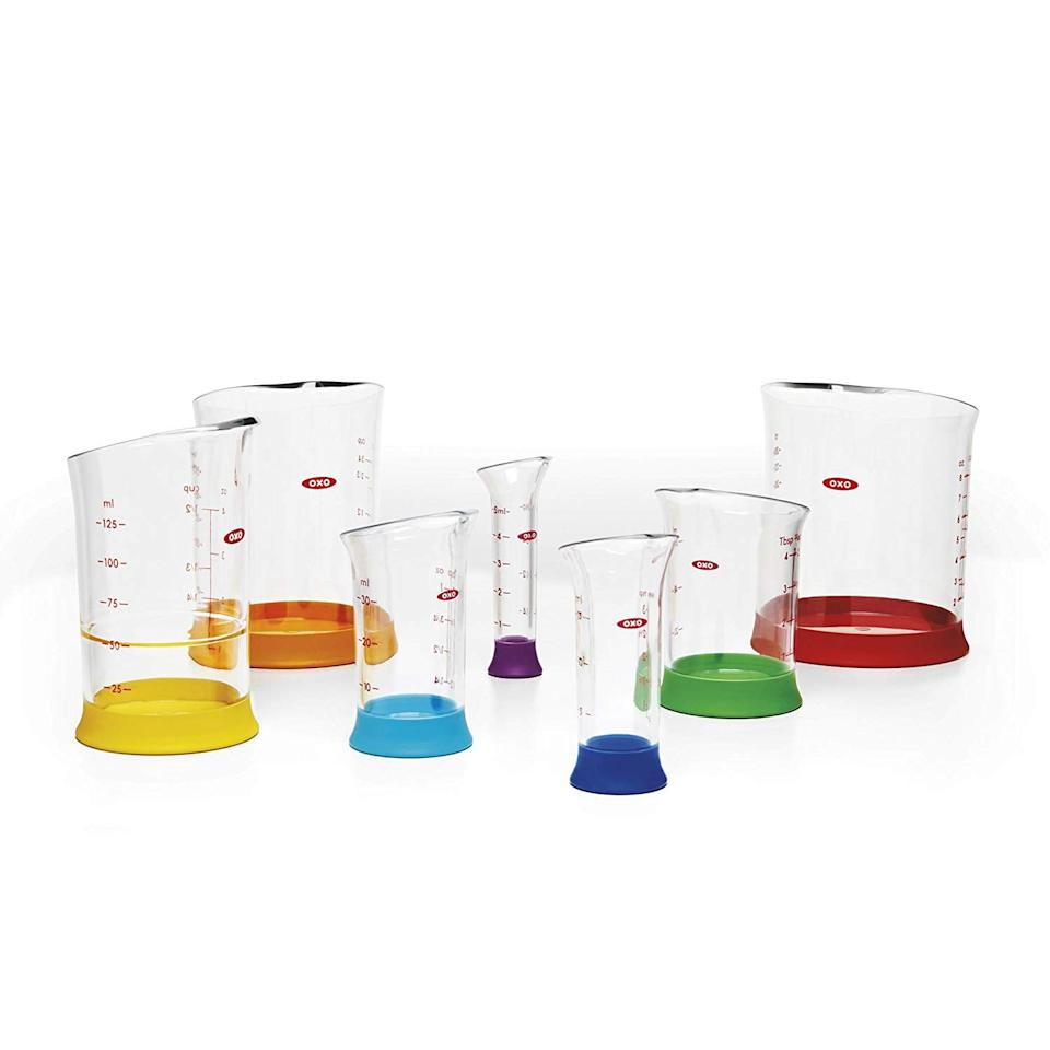 "<p>This colorful <a href=""https://www.popsugar.com/buy/Oxo-Good-Grips-7-Piece-Nesting-Measuring-Beaker-Set-375703?p_name=Oxo%20Good%20Grips%207-Piece%20Nesting%20Measuring%20Beaker%20Set&retailer=amazon.com&pid=375703&price=20&evar1=fit%3Aus&evar9=45413210&evar98=https%3A%2F%2Fwww.popsugar.com%2Fphoto-gallery%2F45413210%2Fimage%2F45413600%2FOxo-Good-Grips-7-Piece-Nesting-Measuring-Beaker-Set&list1=shopping%2Cgifts%2Camazon%2Choliday%2Chealthy%20snacks%2Csnacks%2Cstocking%20stuffers%2Cgift%20guide%2Chealthy%20living%2Cfood%20shopping%2Cgifts%20for%20women%2Cgifts%20for%20men%2Cgifts%20under%20%24100%2Cgifts%20under%20%2450%2Cgifts%20under%20%2475%2Cketo%20diet&prop13=api&pdata=1"" rel=""nofollow"" data-shoppable-link=""1"" target=""_blank"" class=""ga-track"" data-ga-category=""Related"" data-ga-label=""https://www.amazon.com/gp/product/B00LE6FO4Q/ref=as_li_tl?ie=UTF8&amp;camp=1789&amp;creative=390957&amp;creativeASIN=B00LE6FO4Q&amp;linkCode=as2&amp;tag=rume00-20&amp;linkId=XDYN6AEREA4H7RC6"" data-ga-action=""In-Line Links"">Oxo Good Grips 7-Piece Nesting Measuring Beaker Set</a> ($20) will make meal prepping fun.</p>"
