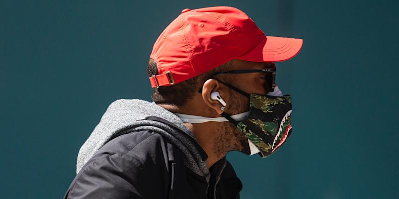 A man wears a double mask as he walks in Times Square on April 6, 2020 in New York City.