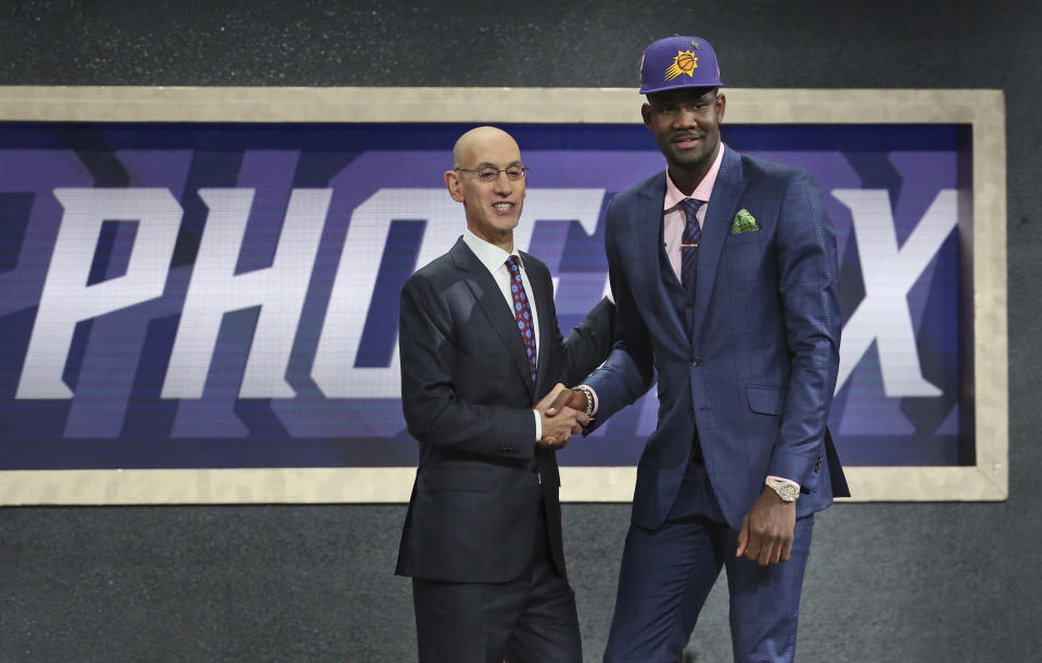 Deandre Ayton, right, poses with NBA commissioner Adam Silver after he was picked No. 1 overall Thursday night. (AP)