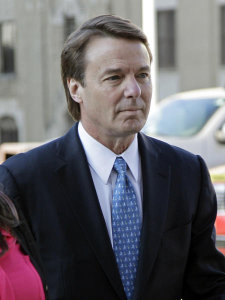 Former presidential candidate and U.S. Sen. John Edwards arrives outside federal court in Greensboro, N.C., Monday, April 23, 2012. for his trial on charges of violating federal campaign finance laws. Opening statements were to begin Monday. Edwards, 58, pleaded not guilty to six criminal counts related to nearly $1 million in secret payments from two wealthy supporters. Much of the money was used to hide the then-married politician's pregnant mistress during his 2008 White House campaign. (AP Photo/Chuck Burton)