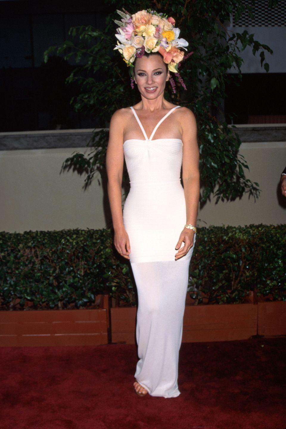 """<p>""""The Nanny"""" actress was statuesque in a white gown and oversized floral arrangement on her head in 1996.</p>"""