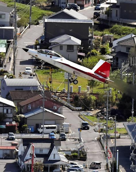 Japan's first stealth fighter jet the X-2 successfully takes to the skies as the country joins a select group of world military powers wielding the radar-dodging technology (AFP Photo/)