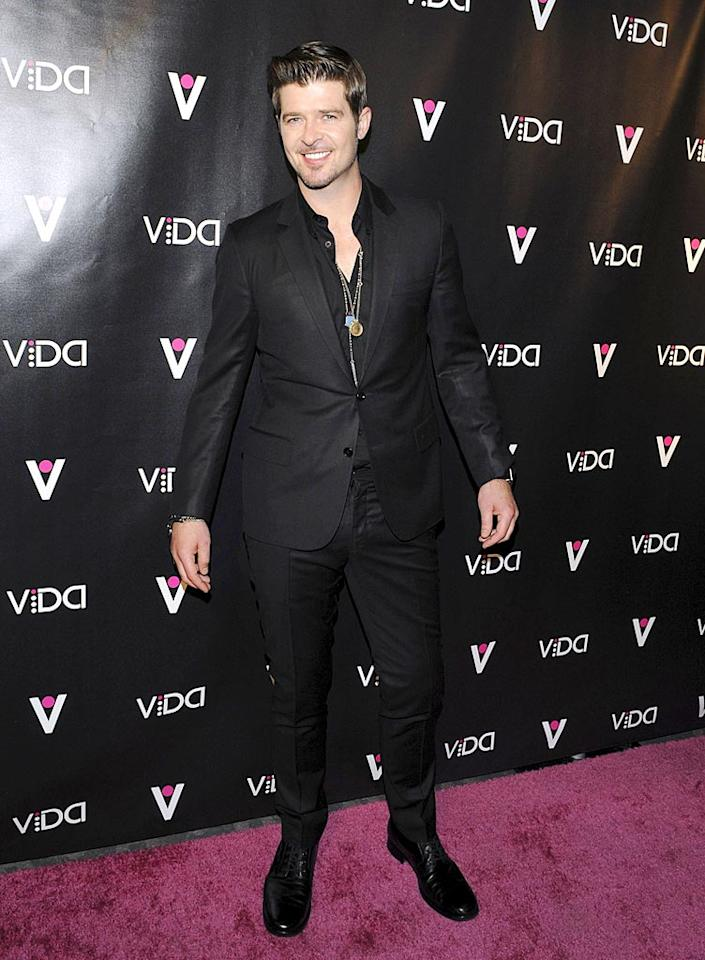 """Think Robin Thicke is attempting to bring sexy back ... again? First he calls his new album """"Sex Therapy,"""" and now he's attending a launch for a """"pleasure"""" toy! Jean Baptiste Lacroix/<a href=""""http://www.wireimage.com"""" target=""""new"""">WireImage.com</a> - January 13, 2010"""