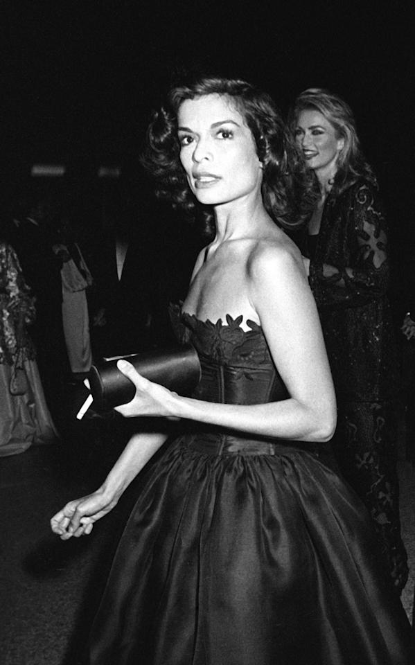 """<p>Bianca Jagger wore her hair shoulder length locks in voluminous curls with a dark smoky eye at the Costume Institute Gala """"The 18th Century Woman"""" in 1981.</p>"""