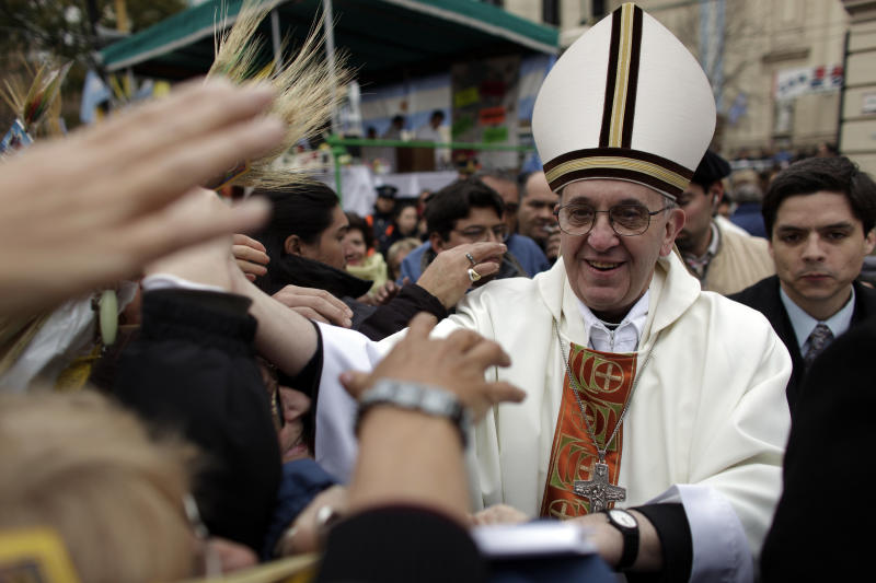 This Aug. 7, 2009 file photo shows Argentina's Cardinal Jorge Bergoglio, right, giving a mass outside San Cayetano church in Buenos Aires. Bergoglio, who took the name of Pope Francis, was elected on Wednesday, March 13, 2013 the 266th pontiff of the Roman Catholic Church. (AP Photo/Natacha Pisarenko, files)