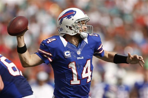 Buffalo Bills quarterback Ryan Fitzpatrick (14) looks to pass during the first half of an NFL football game against the Miami Dolphins, Sunday, Dec. 23, 2012, in Miami . (AP Photo/J Pat Carter)