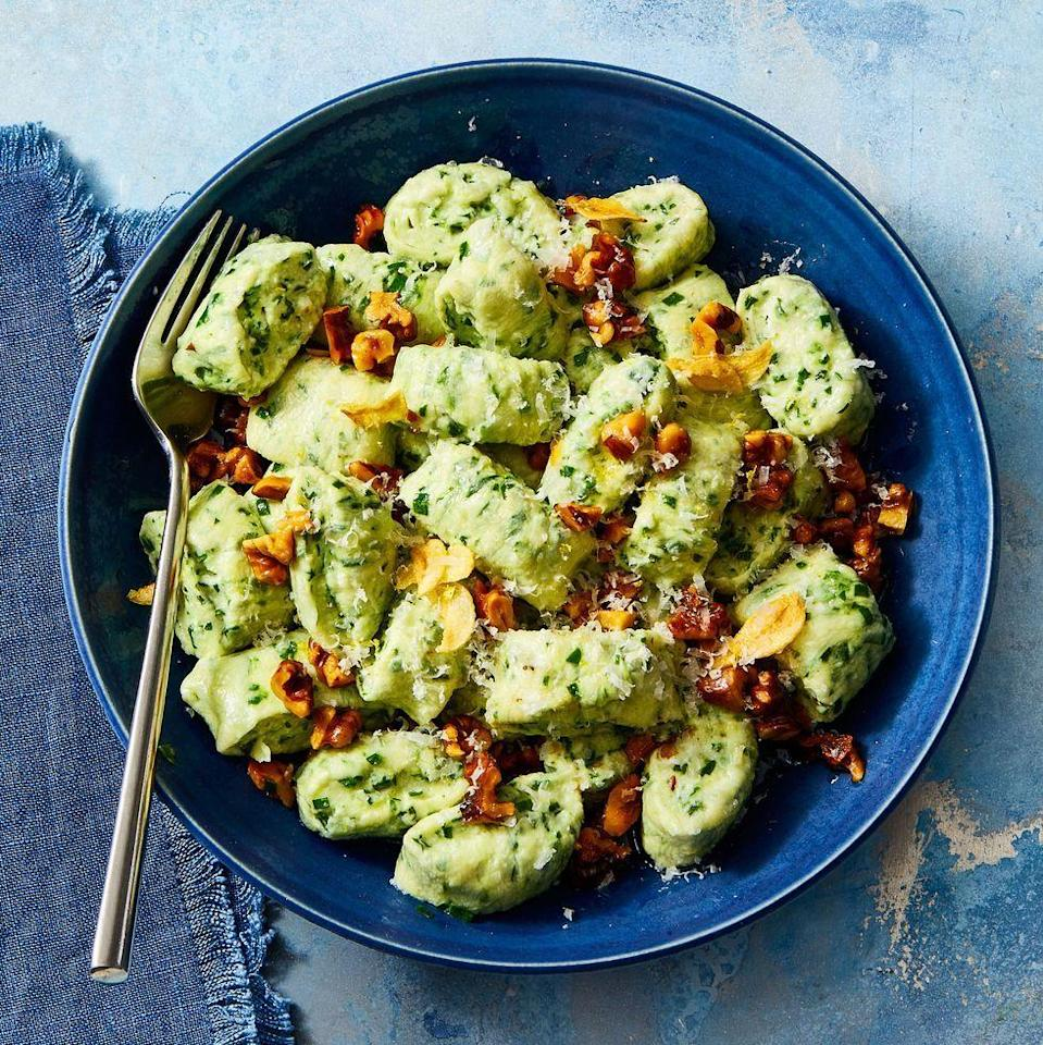 "<p>Switch up your typical weeknight pasta with fluffy spinach-ricotta gnocchi. It's easier to make than you think!</p><p><em><a href=""https://www.goodhousekeeping.com/food-recipes/a34285759/ricotta-gnocchi-with-toasted-garlic-and-walnuts-recipe/"" rel=""nofollow noopener"" target=""_blank"" data-ylk=""slk:Get the recipe for Ricotta Gnocchi With Toasted Garlic & Walnuts »"" class=""link rapid-noclick-resp"">Get the recipe for Ricotta Gnocchi With Toasted Garlic & Walnuts »</a></em></p>"