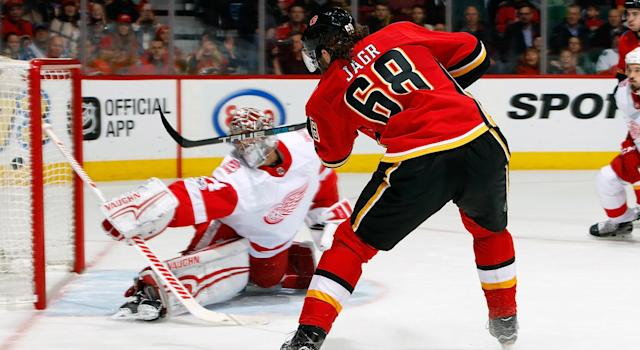 "<a class=""link rapid-noclick-resp"" href=""/nhl/players/35/"" data-ylk=""slk:Jaromir Jagr"">Jaromir Jagr</a> scored his first goal for the <a class=""link rapid-noclick-resp"" href=""/nhl/teams/cgy/"" data-ylk=""slk:Calgary Flames"">Calgary Flames</a> on Thursday night. (Photo by Gerry Thomas/NHLI via Getty Images)"