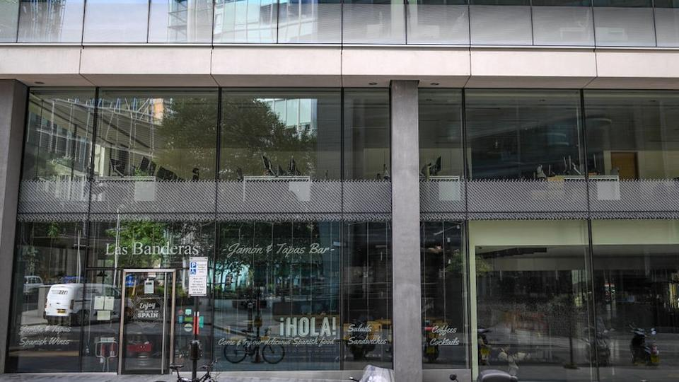 City offices sit empty and cafes remain shut as workers stay at home