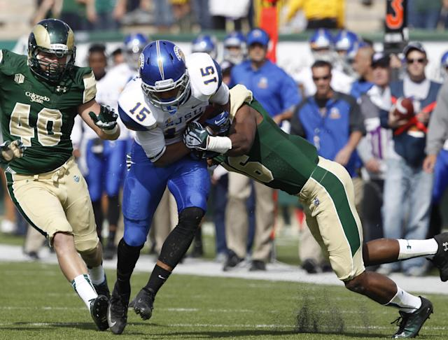 San Jose State wide receiver Tyler Winston, center, is stopped by Colorado State safety Trent Matthews, right, as linebacker Max Morgan, left, comes in to cover in the first quarter of an NCAA college football game in Fort Collins, Colo., on Saturday, Oct. 12, 2013. (AP Photo/David Zalubowski)