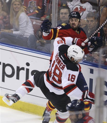 Florida Panthers' Erik Gudbanson (44) and New Jersey Devils' Steve Bernier (18) slam into each other as they vie for the puck during the first period of Game 7 in a first-round NHL Stanley Cup playoff hockey series, in Sunrise, Fla., Wednesday, April 26, 2012. (AP Photo/J Pat Carter)
