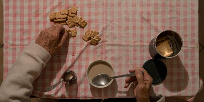 Gino Verani, 87, eats biscuits at home in San Fiorano, one of the towns on lockdown in northern Italy due to a coronavirus outbreak