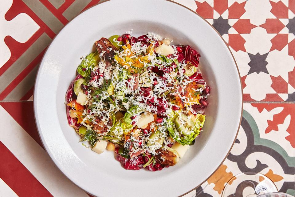 """Toss roasted squash and charred brussels sprouts through a salad of chickpeas, salami, olives, and cheese; add a lemony oregano vinaigrette and enjoy. <a href=""""https://www.epicurious.com/recipes/food/views/che-fico-chopped-salad?mbid=synd_yahoo_rss"""" rel=""""nofollow noopener"""" target=""""_blank"""" data-ylk=""""slk:See recipe."""" class=""""link rapid-noclick-resp"""">See recipe.</a>"""
