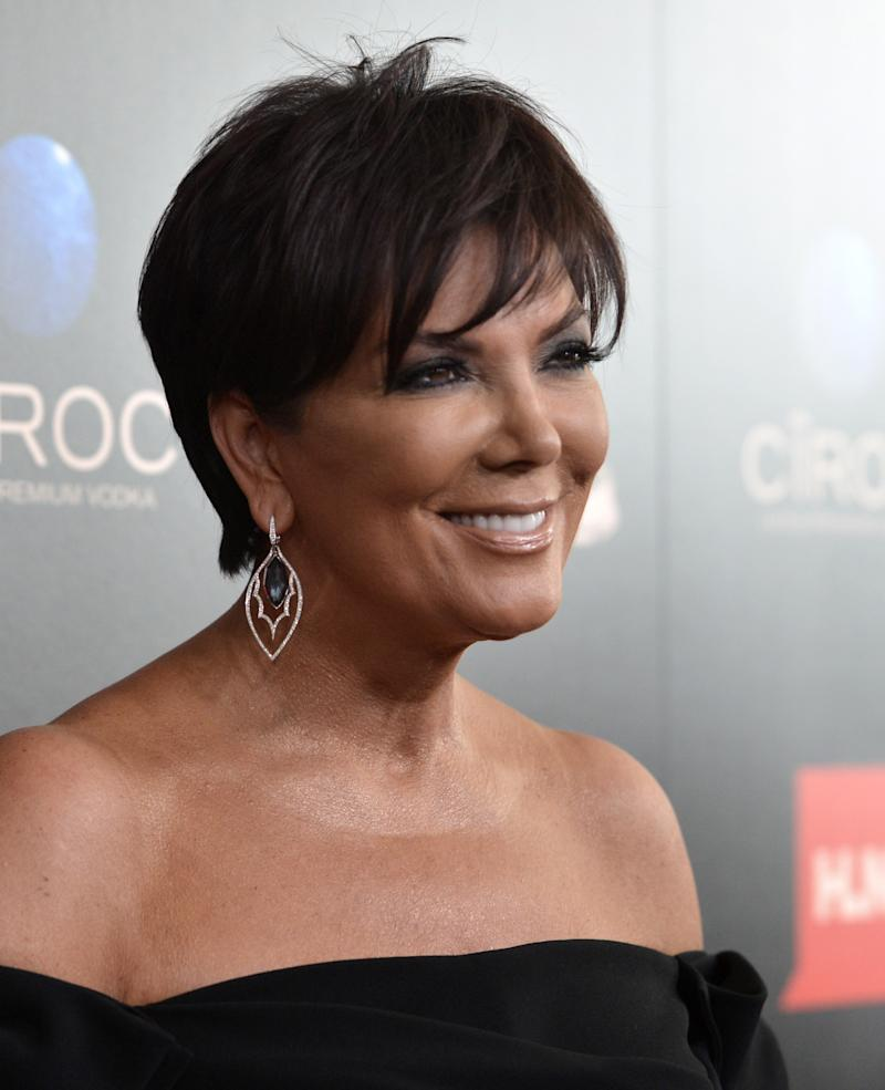 """FILE - In this June 16, 2013 file photo, Kris Jenner arrives at the 40th Annual Daytime Emmy Awards, in Beverly Hills, Calif. Jenner will be joined by Joan Rivers, Kathie Lee Gifford and other co-hosts when her daily talk show, """"Kris,"""" launches July 15, 2013, on select Fox TV stations. (Photo by Richard Shotwell/Invision/AP, File)"""