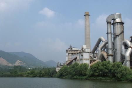 Anhui Conch cement plant is seen by a river in Tongling
