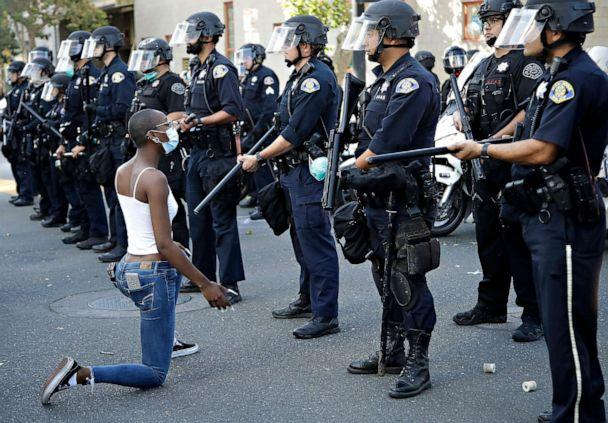 PHOTO: A masked protester kneels before San Jose police, May 29, 2020, in San Jose, Calif., in response to the death of George Floyd in police custody on Memorial Day in Minneapolis. (Ben Margot/AP)