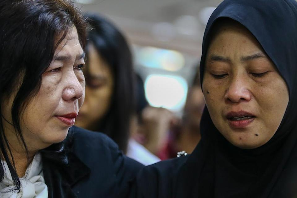 Susanna Koh and Norhayati Mohd Arifin attend the announcement of Suhakam's public inquiry findings into the disappearances of their husbands, pastor Raymond Koh and Amri Che Mat, in Kuala Lumpur April 3, 2019. — Picture by Hari Anggara