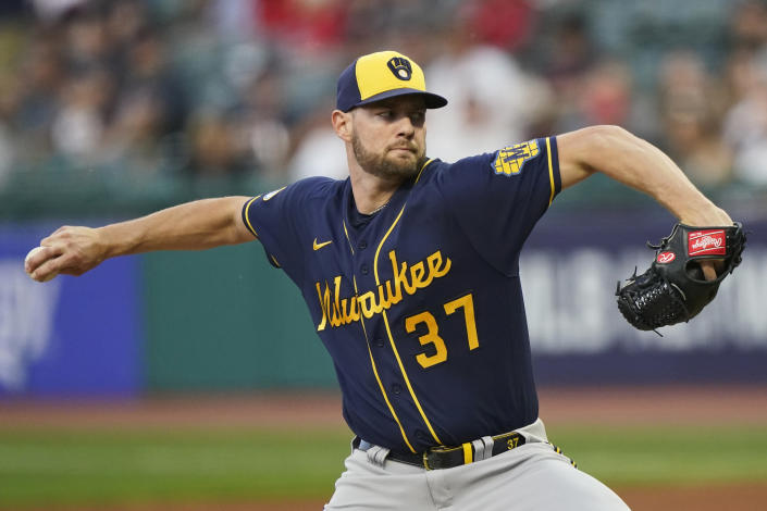 Milwaukee Brewers starting pitcher Adrian Houser delivers in the first inning of a baseball game against the Cleveland Indians, Friday, Sept. 10, 2021, in Cleveland. (AP Photo/Tony Dejak)