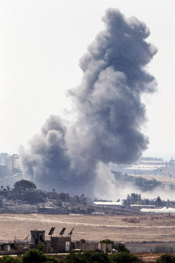A picture taken from the Israeli border with the Gaza Strip shows smoke billowing from the coastal Palestinian enclave following an Israeli air strike on July 29, 2014 (AFP Photo/Jack Guez)