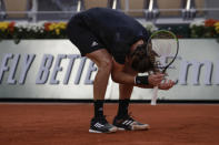 Greece's Stefanos Tsitsipas reacts after missing a shot against Uruguay's Pablo Cuevas in the second round match of the French Open tennis tournament at the Roland Garros stadium in Paris, France, Thursday, Oct. 1, 2020. (AP Photo/Alessandra Tarantino)