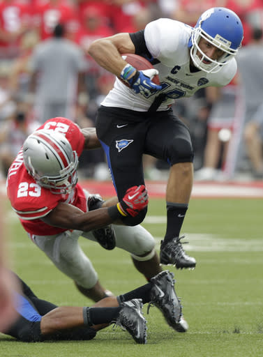 Buffalo wide receiver Alex Neutz, top, tries to get away from Ohio State defensive back Tyvis Powell during the third quarter of an NCAA college football game Saturday, Aug. 31, 2013, in Columbus, Ohio. Ohio State beat Buffalo 40-20. (AP Photo/Jay LaPrete)