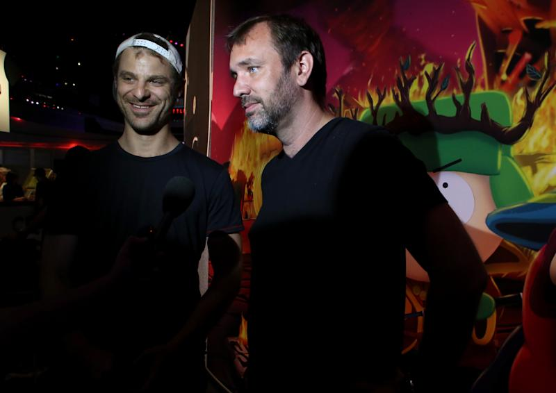"""FILE - This June 12, 2013 file photo released by Ubisoft shows Matt Stone, left, and Trey Parker at the the Ubisoft booth to discuss """"South Park: The Stick of Truth"""" at E3 in Los Angeles. (AP Photo/Ubisoft, Alexandra Wyman, file)"""