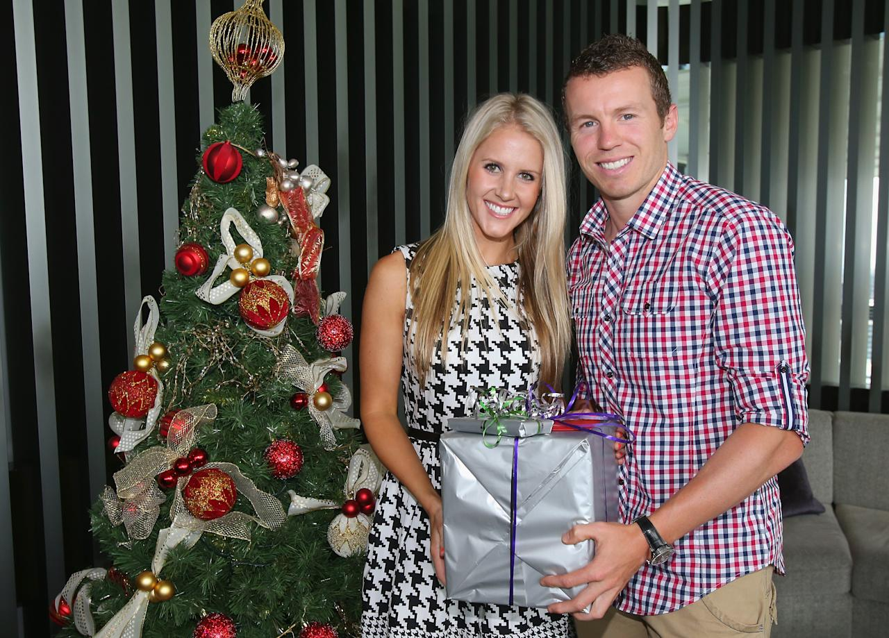 MELBOURNE, AUSTRALIA - DECEMBER 25:  Peter Siddle of Australia and partner Anna Weatherlake pose next to a Christmas tree ahead of a Cricket Australia Christmas Day lunch at Crown Entertainment Complex on December 25, 2012 in Melbourne, Australia.  (Photo by Scott Barbour/Getty Images)