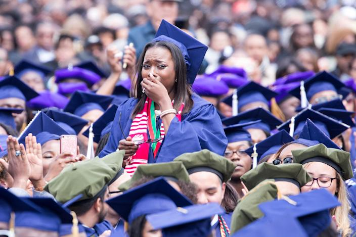 A Howard University graduate cries as speaker Barack Obama tells her story of struggle and triumph, at the 148th Commencement Convocation. (Photo: Cheriss May/NurPhoto/Getty Images)