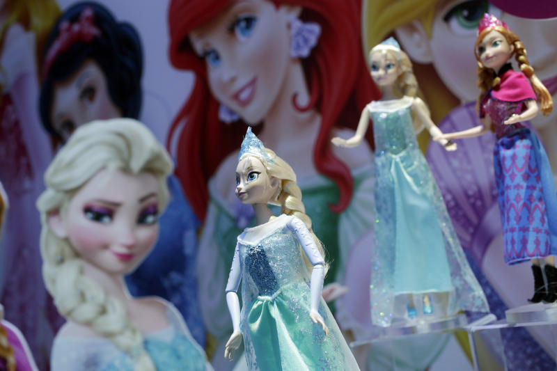"""FILE - In this Feb. 14, 2014, file photo, Disney Frozen Feature Fashion Dolls are displayed at the Mattel booth, Friday,  at the American International Toy Fair in New York. """"Frozen"""" prodcer Peter Del Vecho told Entertainment Weekly for a story published online March 29, 2017, that the original version of the film was more in line with the Hans Christian Andersen tale on which it's based. (AP Photo/Mark Lennihan, File)"""