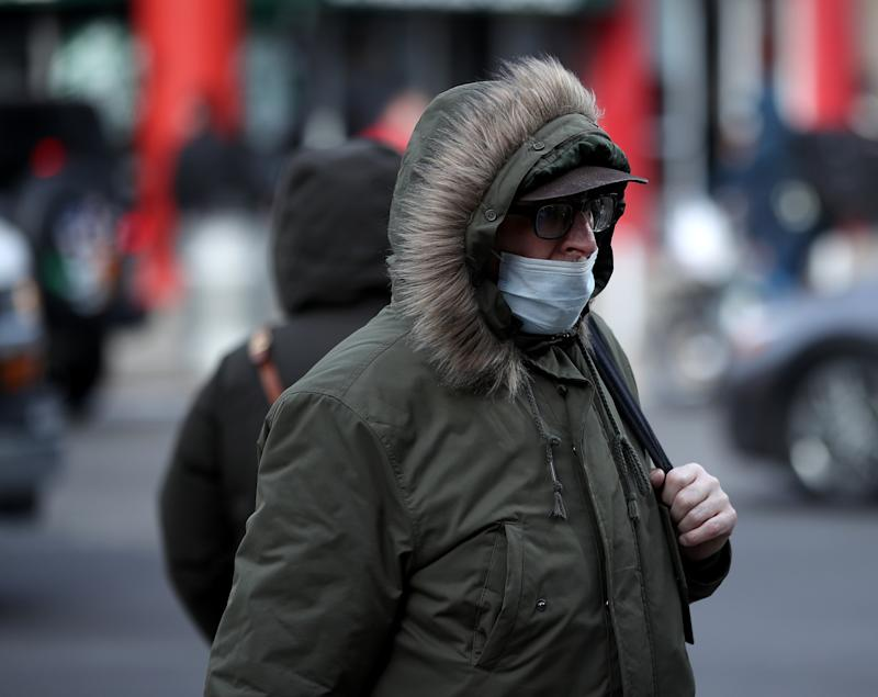 NEW YORK, USA - JANUARY 30: People wear medical masks as a precaution against coronavirus, walking around the in the streets of New York, United States on January 30, 2020. The World Health Organization declared coronavirus a public health emergency of international concern. (Photo by Tayfun Coskun/Anadolu Agency via Getty Images)