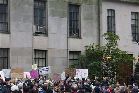 Eastside Catholic High School students are pictured during a rally in support of the school's former Vice Principal Mark Zmuda at the Archdiocese of Seattle chancery building in Seattle, Washington, December 20, 2013. REUTERS/David Ryder
