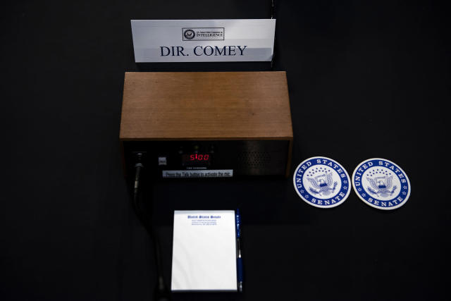 <p>Ousted FBI director James Comey's seat at the witness table is seen before a hearing of the Senate Select Committee on Intelligence on Capitol Hill June 8, 2017 in Washington. (Photo: Brendan Smialowski/AFP/Getty Images) </p>
