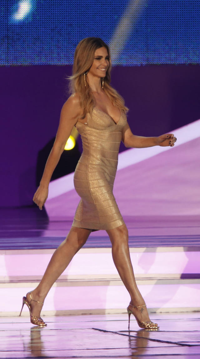 Brazilian actress Fernanda Lima walks over the stage during the draw ceremony for the 2014 soccer World Cup in Costa do Sauipe near Salvador, Brazil, Friday, Dec. 6, 2013. (AP Photo/Silvia Izquierdo)