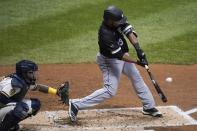 Chicago White Sox's Edwin Encarnacion hits a single during the fourth inning of a baseball game against the Milwaukee Brewers Tuesday, Aug. 4, 2020, in Milwaukee. (AP Photo/Morry Gash)