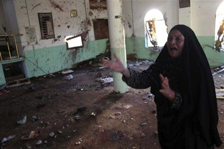 A woman reacts inside a Sunni mosque after two roadside bombs attacks on Sunni Muslim worshippers following Friday prayers in Baquba