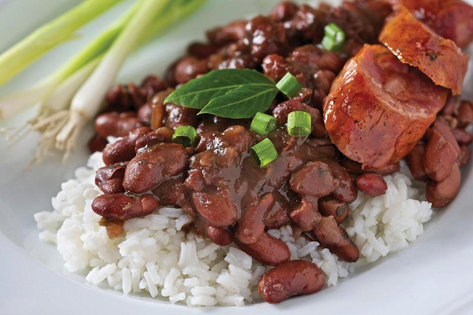 """The classic Creole dish of red beans and rice is easy to make in a slow cooker. Combine a pound of red beans with onion, celery, garlic, smoked sausage, ham hock, Worcestershire sauce, and bay leaves. Add a dash of hot sauce when it's done cooking. <a href=""""https://www.epicurious.com/recipes/food/views/royal-street-red-beans-51224230?mbid=synd_yahoo_rss"""" rel=""""nofollow noopener"""" target=""""_blank"""" data-ylk=""""slk:See recipe."""" class=""""link rapid-noclick-resp"""">See recipe.</a>"""