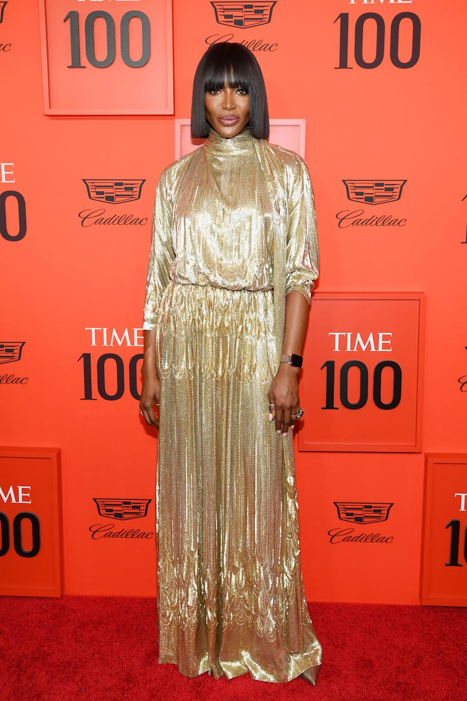 Sporting a razor sharp bob and a rare fringe, Campbell's old Hollywood glamour look is a winner. She often opts for floor-length gowns on the red carpet, but this gold Valentino gown is something special. [Getty Images]