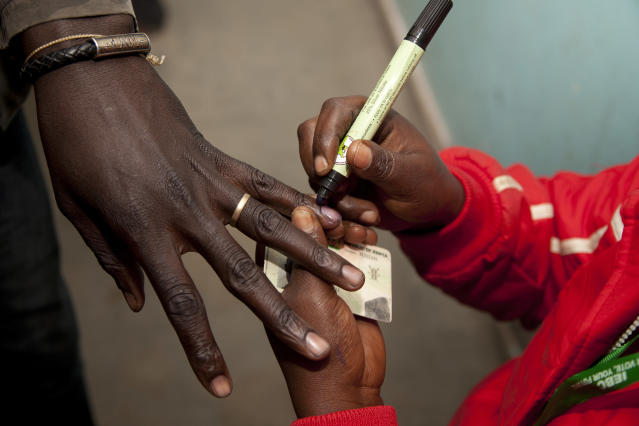 <p>A polling official marks a voter's finger after casting his vote at a polling station in Nairobi, Kenya, Tuesday, Aug. 8, 2017. (Photo: Sayyid Abdul Azim/AP) </p>
