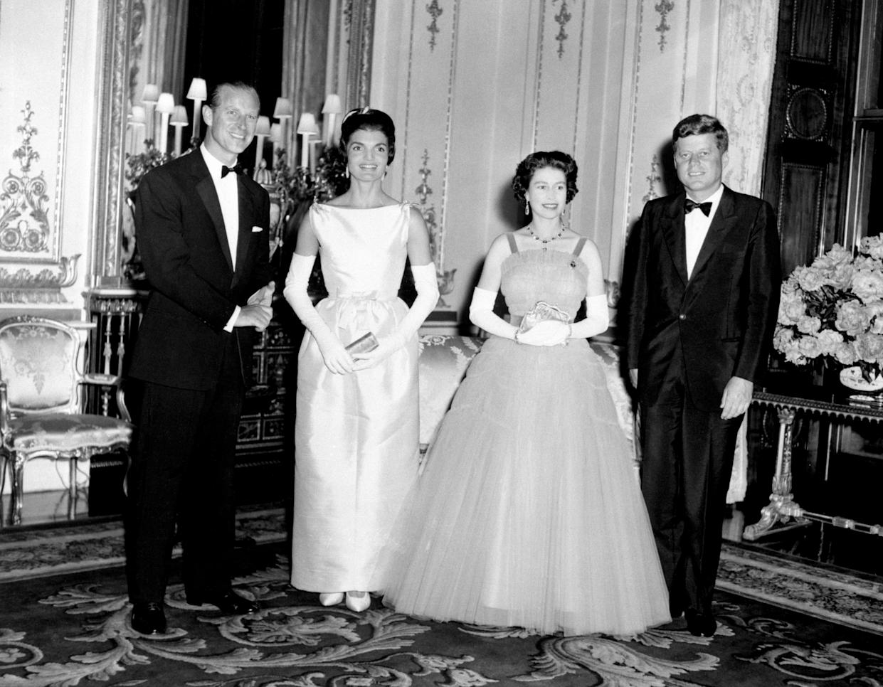 American President John Kennedy (right) and his wife Jacqueline (2nd left) pictured with Queen Elizabeth II (2nd right) and the Duke of Edinburgh at Buckingham Palace, in London.