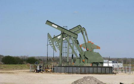 FILE PHOTO: A pump jack used to help lift crude oil from a well in South Texas' Eagle Ford Shale formation stands idle in Dewitt County Texas