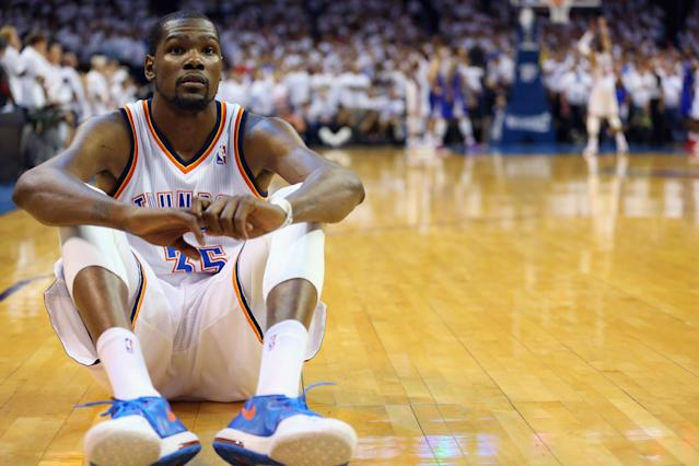 OKLAHOMA CITY, OK - MAY 13: Kevin Durant #35 of the Oklahoma City Thunder sits on the court as Russell Westbrook makes three free throws against the Los Angeles Clippers to take the lead in Game Five of the Western Conference Semifinals during the 2014 NBA Playoffs at Chesapeake Energy Arena on May 13, 2014 in Oklahoma City, Oklahoma. NOTE TO USER: User expressly acknowledges and agrees that, by downloading and or using this photograph, User is consenting to the terms and conditions of the Getty Images License Agreement. (Photo by Ronald Martinez/Getty Images)