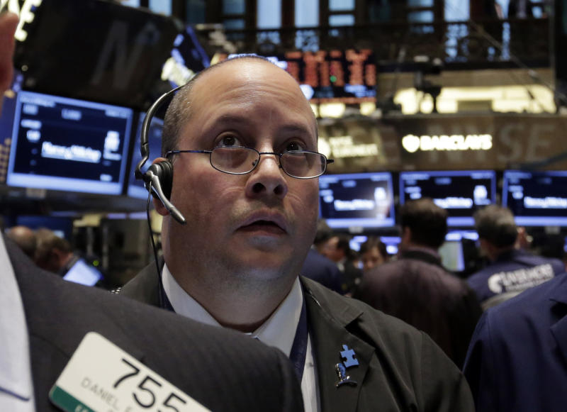 Trader Jeffrey Vazquez works on the floor of the New York Stock Exchange Thursday, Oct. 31, 2013. Stocks edged lower in early trading on Wall Street Thursday, paring the market's big gain for October. (AP Photo/Richard Drew)