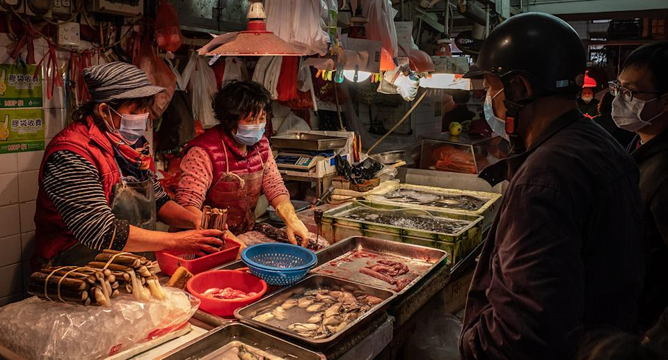 MACAU, CHINA - JANUARY 28: Residents wearing face masks purchase seafood at a wet market on January 28, 2020 in Macau, China. The number of cases of a deadly new coronavirus rose to over 4000 in mainland China Tuesday as health officials locked down the city of Wuhan last week in an effort to contain the spread of the pneumonia-like disease which medicals experts have confirmed can be passed from human to human. In an unprecedented move, Chinese authorities put travel restrictions on the city which is the epicentre of the virus and neighbouring municipalities affecting tens of millions of people.  At least six people have reportedly contracted the virus in Macau. The number of those who have died from the virus in China climbed to over 100 on Tuesday and cases have been reported in other countries including the United States, Canada, Australia, France, Thailand, Japan, Taiwan and South Korea.  (Photo by Anthony Kwan/Getty Images)