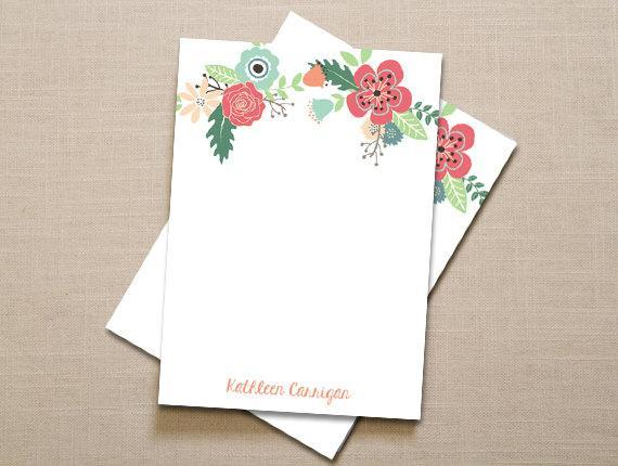 """Set of Two Painted Floral Notepads; $18 at <a href=""""https://www.etsy.com/listing/115143541/personalized-notepad-set-of-two-painted?ref=sr_gallery_17&ga_search_query=notepad&ga_page=12&ga_search_type=all&ga_view_type=gallery"""" rel=""""nofollow noopener"""" target=""""_blank"""" data-ylk=""""slk:etsy.com"""" class=""""link rapid-noclick-resp""""><em>etsy.com</em></a>"""