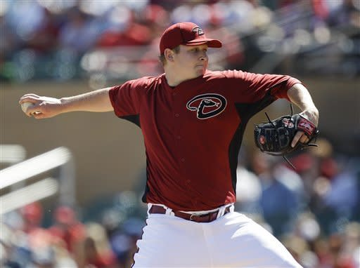 Arizona Diamondbacks starting pitcher Trevor Cahill throws to the Los Angeles Angels during the first inning of a spring training baseball game, Tuesday, March 13, 2012 in Scottsdale, Ariz. (AP Photo/Marcio Jose Sanchez)