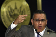 El Salvador's President Mauricio Funes, speaks at a news conference, in San Salvador, El Salvador, Wednesday March 28, 2012, where he denied that his government has engaged in negotiations with the gangs to lower the rate of homicides, and called for a national agreement to end violence and social exclusion. (AP Photo/Luis Romero)
